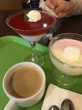 Jelly, desserts and coffee Cup are on the Green tray. Girl reviews check for the service royalty free stock photo