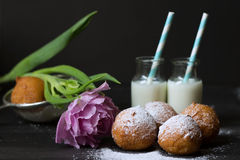 Jelly doughnuts, tulip and two bottles of milk Stock Images