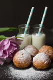 Jelly doughnuts and two bottles of milk Royalty Free Stock Image