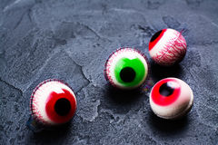 Jelly eyeballs on dark. Funny halloween treat - jelly eyeballs on dark background. Copy space Royalty Free Stock Photos