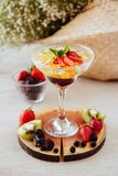 Jelly with fresh berries on table. stock photography