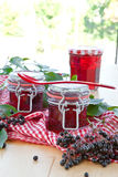 Jelly and fresh elder berries Stock Photo
