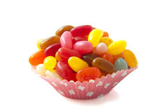Jelly fun. Jelly beans in a cup isolated over white stock images