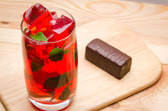 Jelly in a glass and a chocolate Stock Image