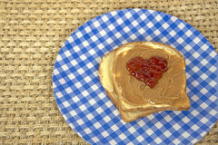 Jelly heart on peanut butter sandwich Royalty Free Stock Photos