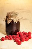 Jelly jar on wooden table Royalty Free Stock Photography