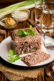 Jelly with meat, beef aspic, traditional Russian dish, portion. On a plate, mustard and horseradish stock images