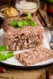 Jelly with meat, beef aspic, traditional Russian dish, portion. On a plate, mustard and horseradish stock photography
