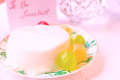 Jelly Milk Dessert with Candies Stock Photography