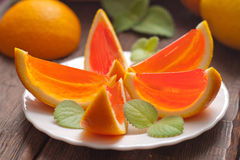Jelly orange slices on a plate. Stock Image