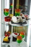 Jelly and other desserts in a transparent refrigerator.  royalty free stock photos