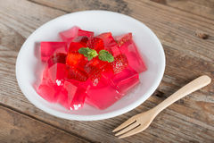 Jelly strawberry with fresh strawberry slices. Royalty Free Stock Photos