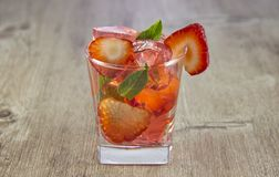 Jelly from strawberry juice with the addition of fresh berries. royalty free stock images