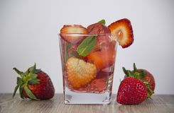 Jelly from strawberry juice with the addition of fresh berries. stock photo