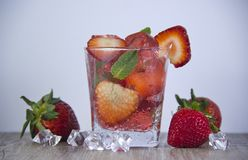 Jelly from strawberry juice with the addition of fresh berries. stock photos