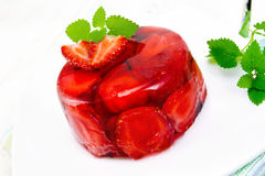 Jelly strawberry with mint on napkin and light board royalty free stock image