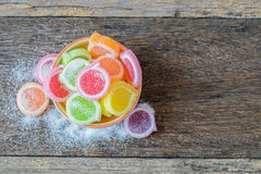 Jelly sweet, flavor fruit, candy dessert colorful. Jelly sweet, flavor fruit, candy dessert colorful in ceramic bowl on wood background Stock Images