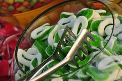 Jelly sweets. A bowl of kiwifruit taste jelly sweets for sale Royalty Free Stock Photography