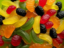 Jelly sweets. Colorful jelly sweets on green background Royalty Free Stock Photography