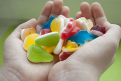 Jelly sweets. In the hands Stock Image