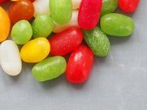 Jellybean sweets on grey background stock photo