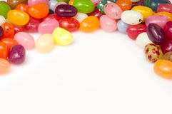 Jellybeans. Arranged on awhite background to leave space for  text Royalty Free Stock Photography