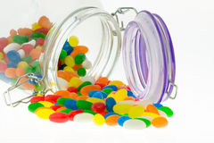 Jellybeans. Colourful Jellybean sweets from a jar on a white background Royalty Free Stock Photos