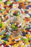 Jellybeans com um frasco cheio imagem de stock royalty free