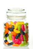 Jellybeans in a glass jar. With white background Royalty Free Stock Images