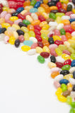 Jellybeans op witte achtergrond stock foto's