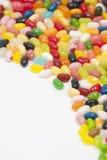 Jellybeans su priorità bassa bianca fotografie stock
