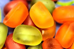 Jellybeans triangle. Colorful closeup photo of jellybeans with the triangle composed of three of them Stock Photo