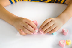 Jellys för barnhandlek på den vita tabellen royaltyfria foton