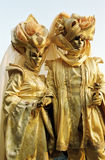 Jelow couple, Carnival mask in Venice, Italy. Tourists disguised in centre of Venice during Carnaval, Italy Royalty Free Stock Image