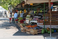 Local food market in Croatia. Jelsa, Hvar, island, Croatia, 2017: fresh ripe juicy fruits, vegetables, oil and local food in a farmer`s market royalty free stock photography