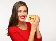 jem hamburgera kobieta Odosobniony portret na bielu Fotografia Stock