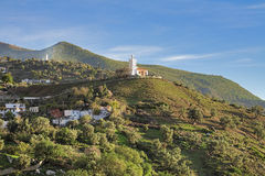 Jemaa Bouzafar mosque on a hill above the town of Chefchaouen Stock Photo