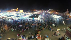 Jemaa el Fna in  Marrakesh Medina Morocco at night. Aerial view on busy market at night, timelapse.  stock video footage