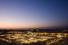 The Jemaa el-Fna Square. Morocco. Marrakech. The Jemaa el-Fna Square at sunset. Blurred motion in the foreground royalty free stock photography