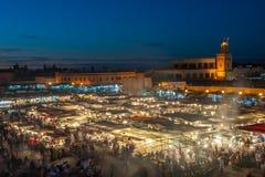 Jemaa el-Fnaa, квадрат и рыночное месте в Marrakesh, Марокко Стоковые Фото