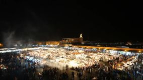 Jemaa el-Fnaa square at night and market place in Marrakesh stock video