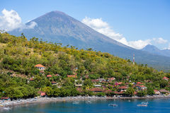 Jemeluk Beach and beautiful blue lagoon with Gunung Agung volcano Royalty Free Stock Images