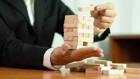 Jenga business game, business fulfillment Building a business base Failed business base Stable and unstable business base. Jenga business game business royalty free stock photo