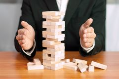 Jenga business game, business fulfillment Building a business base Failed business base Stable and unstable business base. Jenga business game business royalty free stock image