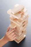 Jenga with hand Royalty Free Stock Photo