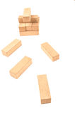 Jenga tower colapsing on a white background Royalty Free Stock Photo