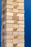Jenga tower constructed with blue background Stock Photo