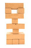 Jenga tower with missing pieces on a white Royalty Free Stock Image