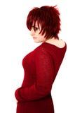 Jengibre adolescente en rojo Foto de archivo