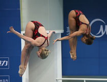 Jennifer Abel and Emilie Heymans of Canada. BEIJING - MARCH 25: Jennifer Abel and Emilie Heymans of Canada perform during Women's 3m Springboard Synchro Final of Stock Photos